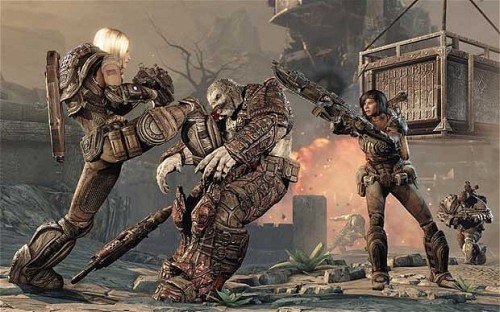 Two female characters taking down a Locust soldier in Gears of War 3.